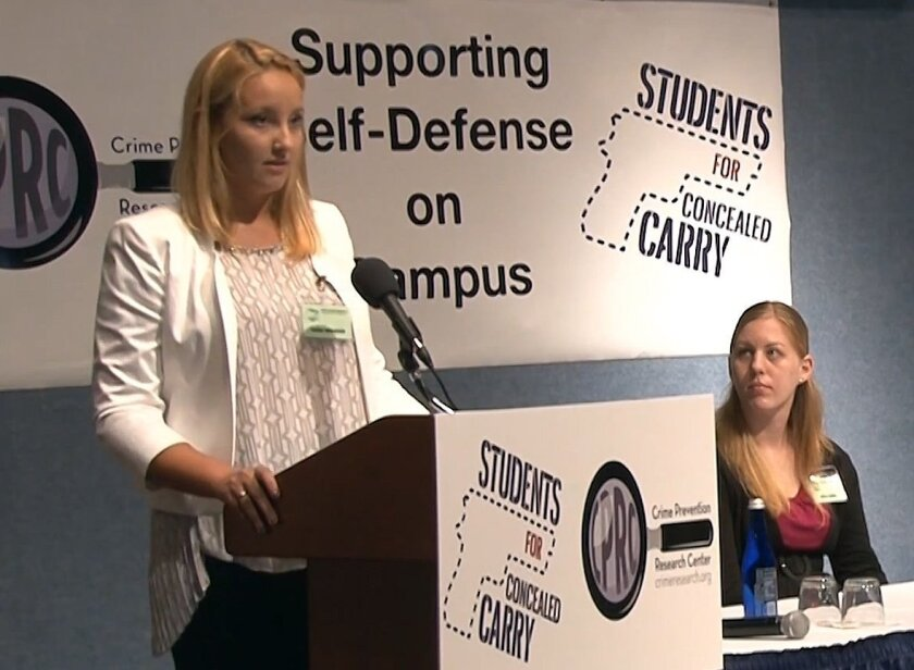 Frame grab from a YouTube video featuring Dartmouth junior Taylor Woolrich (L), speaking at the Students For Concealed Carry national conference at the National Press Club in Washington, D.C. Woman at right is unidentified.