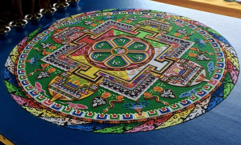 The five monks created a colorful two-dimensional sand mandala that was intricately detailed with Tibetan metaphysical symbols and elements.