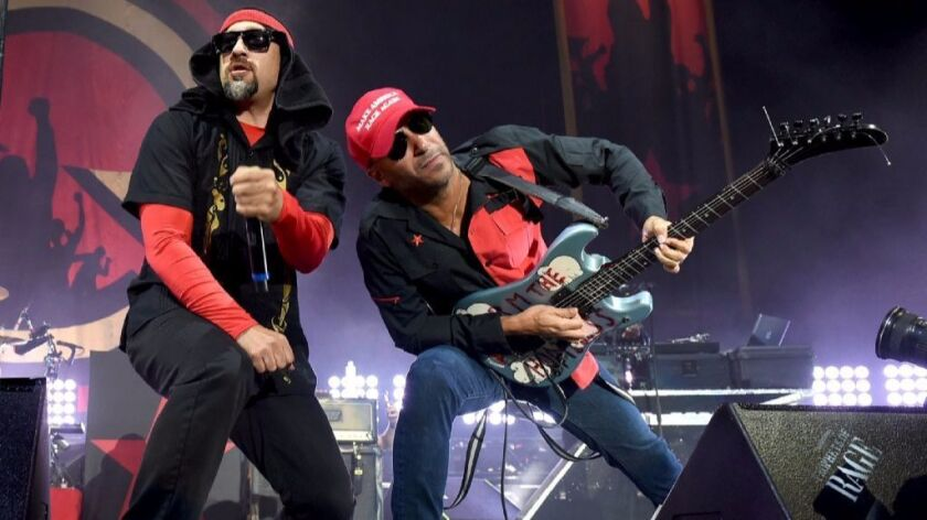 Rapper B-Real (left) and guitarist Tom Morello of Prophets of Rage perform at the Forum in Los Angeles on September 15, 2016. The new band concludes its first tour Oct. 15 in San Diego.