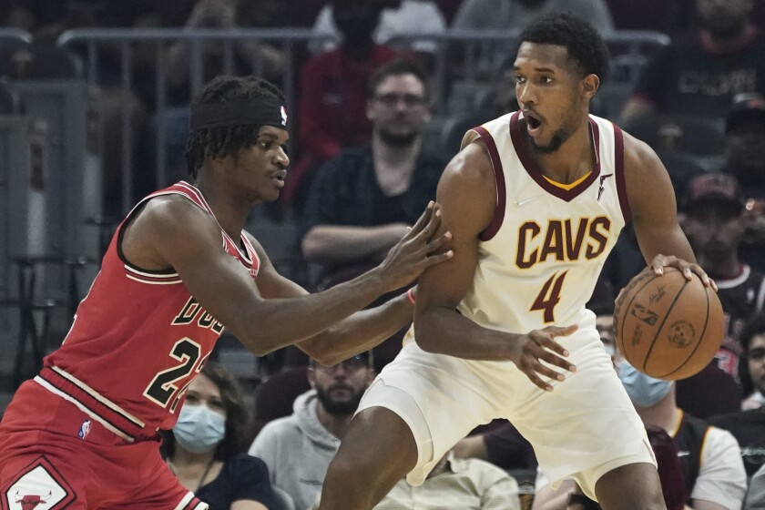 Cleveland Cavaliers' Evan Mobley (4) drives against Chicago Bulls' Alize Johnson (22) in the first half of an NBA preseason basketball game, Sunday, Oct. 10, 2021, in Cleveland. (AP Photo/Tony Dejak)