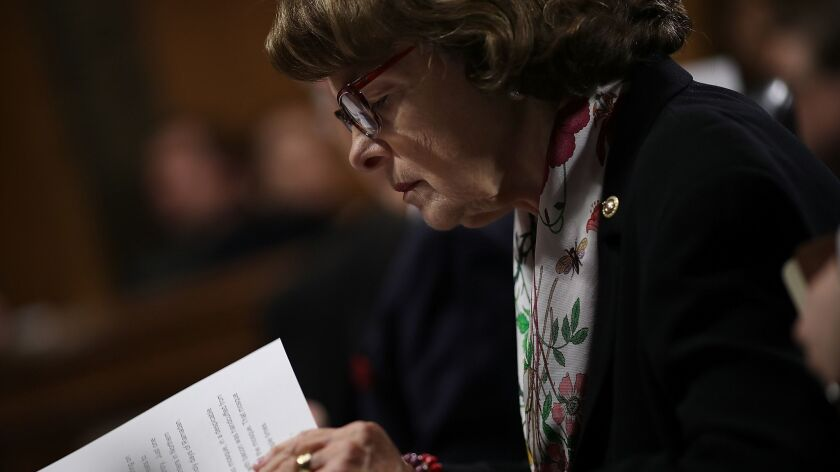 Sen. Dianne Feinstein (D-Calif.), the ranking Democrat on the Senate Judiciary Committee, studies her notes during a committee hearing.