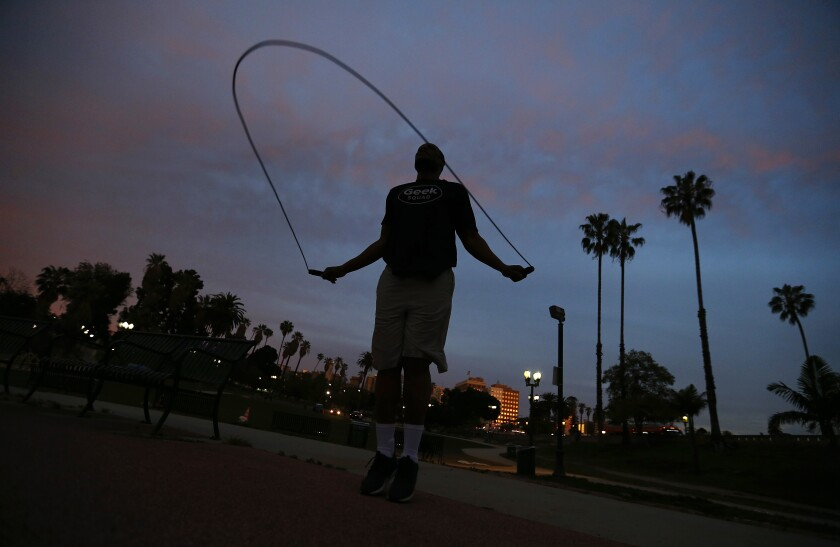 Henry Brown, 42, exercises in MacArthur Park in the Westlake District of L.A. on March 31.