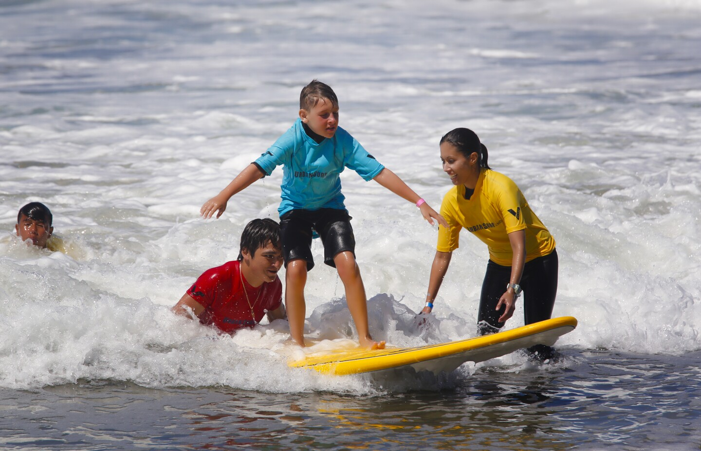 Logan Fischer, 9 from Prescott Valley Arizona enjoyed his second year at the annual Blind Surf event held at South Ponto State Beach in Carlsbad on Sunday.