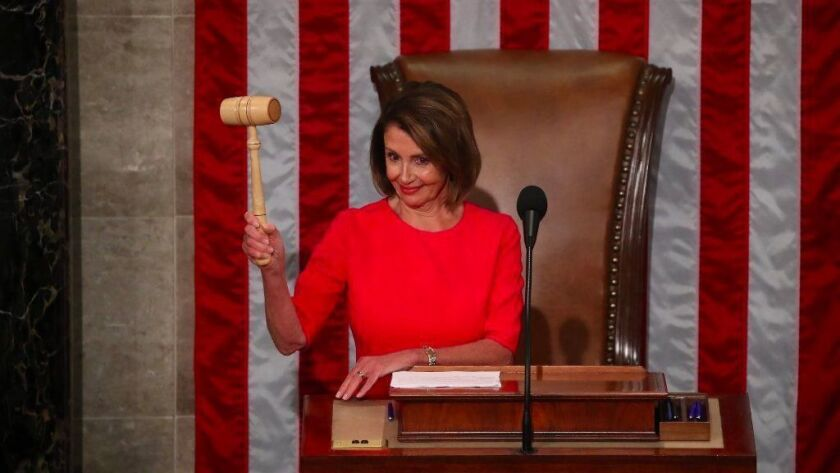 House Speaker Nancy Pelosi holds the gavel during the first session of the 116th Congress.