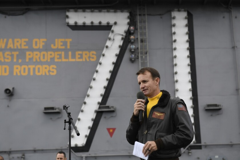 Capt. Brett Crozier, then the commanding officer of the aircraft carrier USS Theodore Roosevelt, addressed crew on a flight deck. Crozier was removed from command after a letter he wrote asking for the Navy's help with a COVID-19 outbreak on board was widely disseminated.