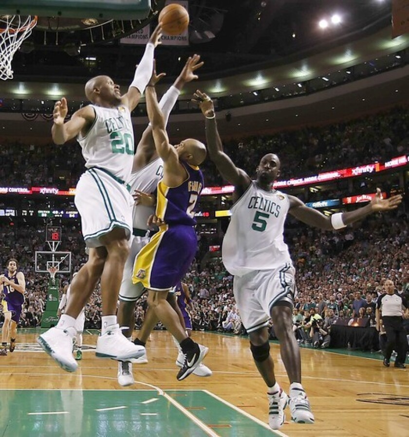 Derek Fisher lofts a shot over three Celtics to help the Lakers clinch a Game 3 victory over the Celtics during the 2010 NBA Finals.