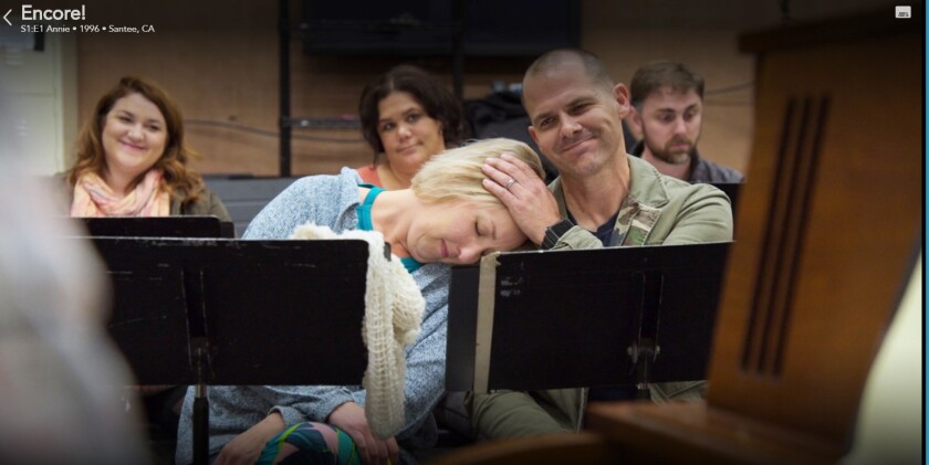 "Annie and Jeremy, foreground, take a breather during rehearsals in a scene from the premiere episode of ""Encore!"" on the  Disney+ streaming service."