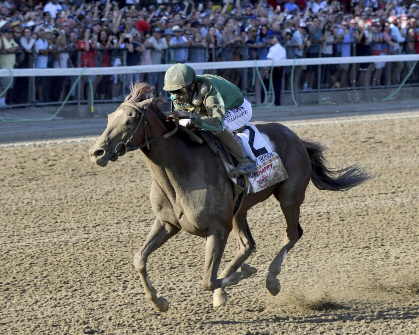 Code of Honor, with jockey John Velazquez, wins the Travers Stakes.