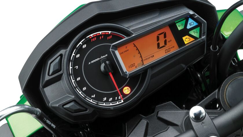 The race-themed LCD digital gauge display includes a tachometer, fuel-level gauge, clock, trip meter