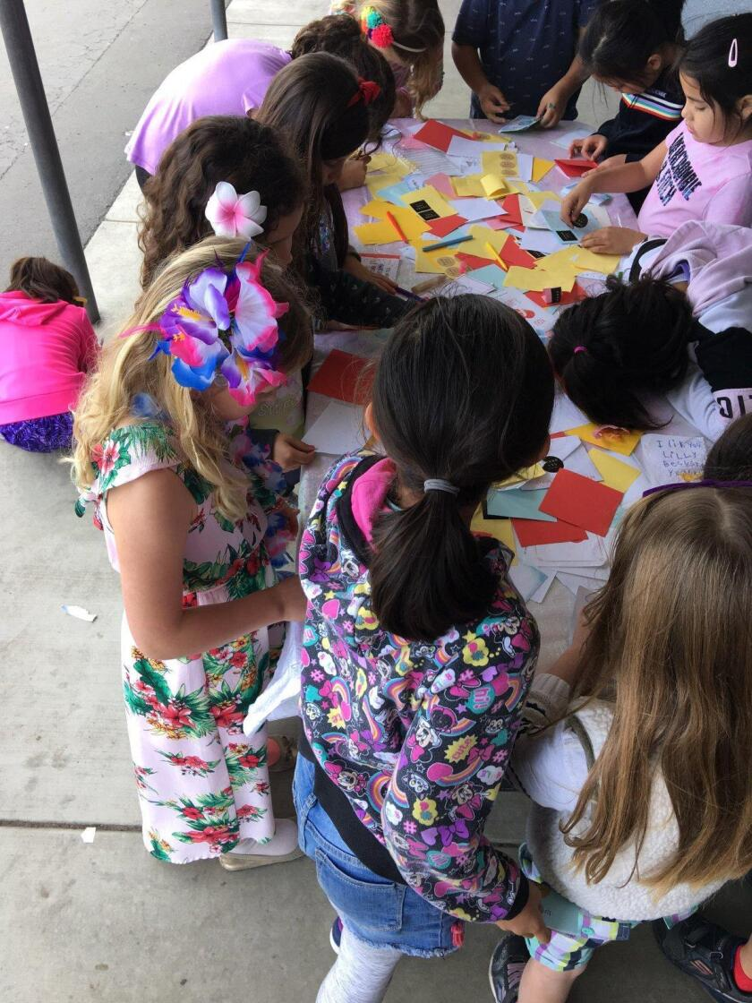 Torrey Pines Elementary School students write 'kindness letters' at stations during recess.