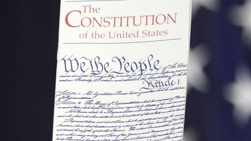 FILE - In this March 23, 2016 photo, the Constitution is held by a member of Congress on Capitol Hil