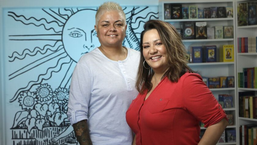 Alex Naranjo, left, and Marlene Vargas opened the first House of Intuition store in Los Angeles in 2010. This one in Highland Park is their sixth and newest store specializing in spiritual goods and gifts.