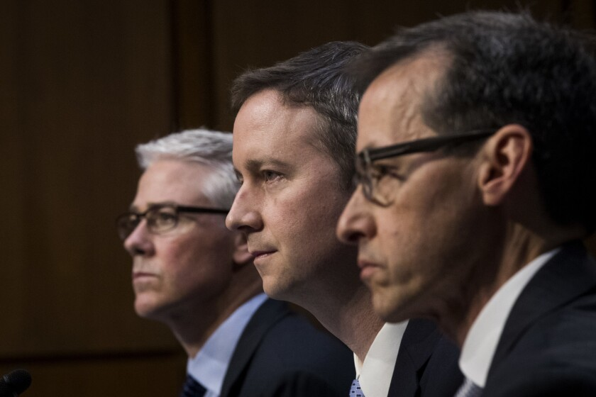 Colin Stretch, general counsel at Facebook, left, Sean Edgett, acting general counsel at Twitter, and Richard Salgado, director of law enforcement and information security at Google, testify before a Senate panel.