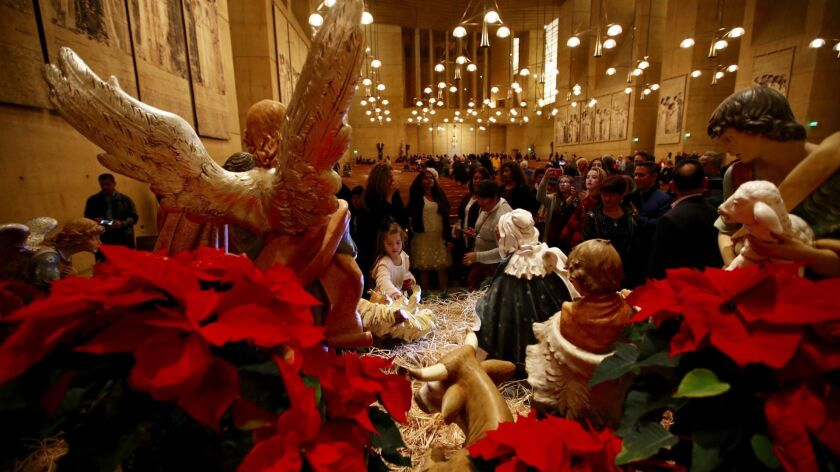 Parishioners view the nativity  scene near the altar after the Family mass  at Our Lady of the Angels Cathedral on Christmas Eve