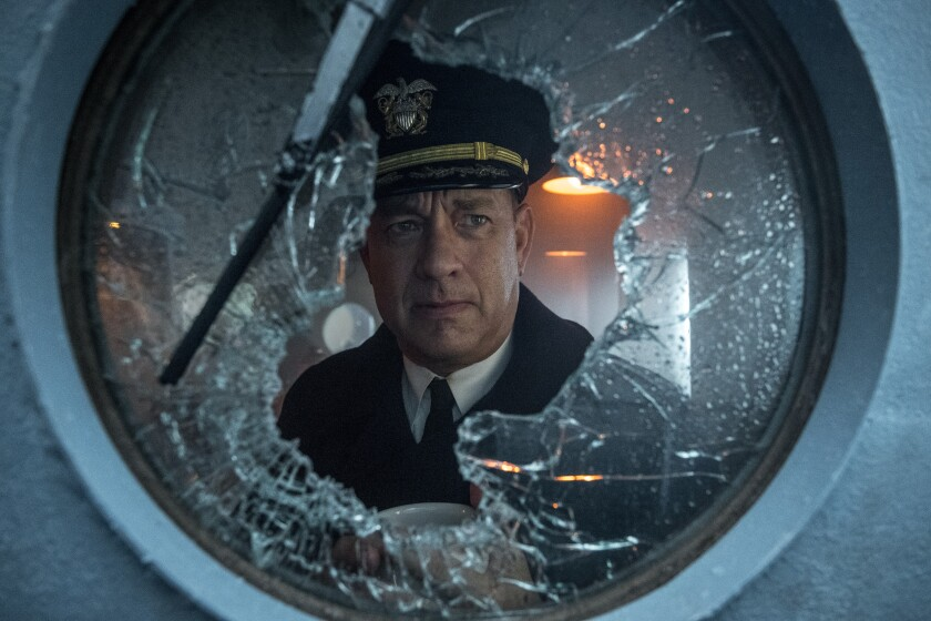 "Tom Hanks dressed in a captain's uniform for the WWII ocean battle film ""Greyhound."""