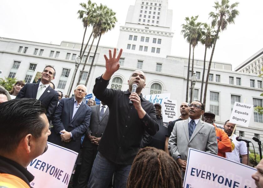 LOS ANGELES, CALIF. -- FRIDAY, MAY 18, 2018: Homeless advocate Mel Tillekeratne speaks to a broad c