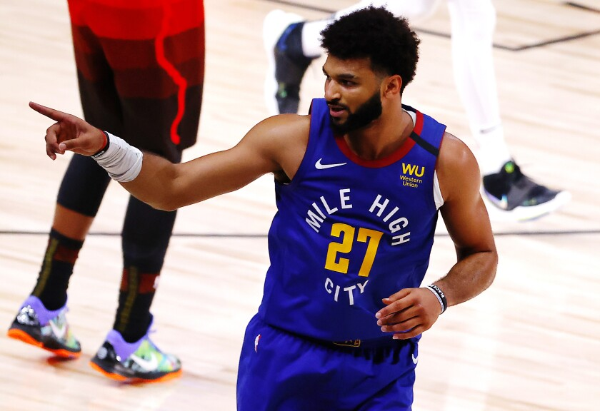The Nuggets' Jamal Murray reacts after a three-pointer against the Jazz during double overtime Aug. 8, 2020.