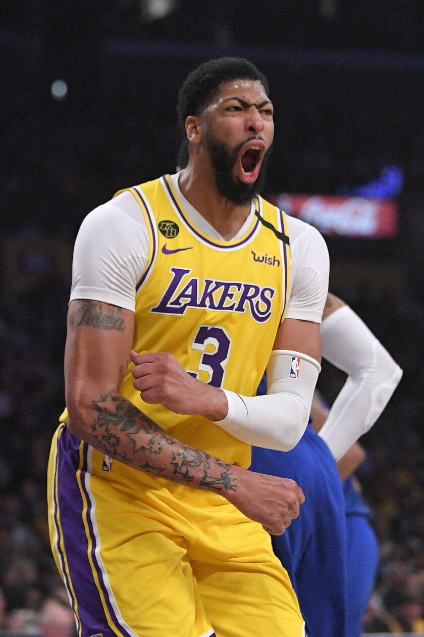 Los Angeles Lakers forward Anthony Davis celebrates after scoring during the first half of an NBA basketball game against the Philadelphia 76ers Tuesday, March 3, 2020, in Los Angeles. (AP Photo/Mark J. Terrill)