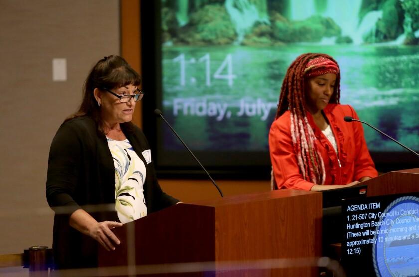 Catherine Kowertz, left, and Dom Jones speak to the Huntington Beach City Council