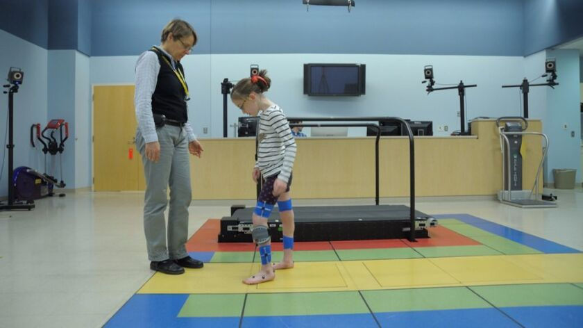 Researchers in the NIH Clinical Center's Rehabilitation Medicine Department are studying an electrical stimulation device for children with cerebral palsy.