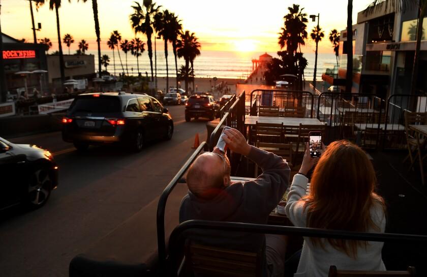 Bryan Yudko and his wife Pam enjoy a meal along Manhattan Beach Boulevard in Manhattan Beach on Dec. 4.