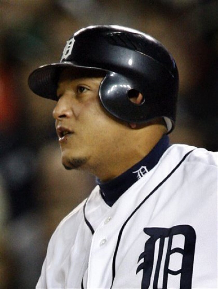 Detroit Tigers Miguel Cabrera watches a foul ball during the third inning of a baseball game in Detroit, Saturday, Oct. 3, 2009. Cabrera was hitless in four at-bats with runners on base in the Tigers' 5-1 loss to the Chicago White Sox. (AP Photo/Carlos Osorio)