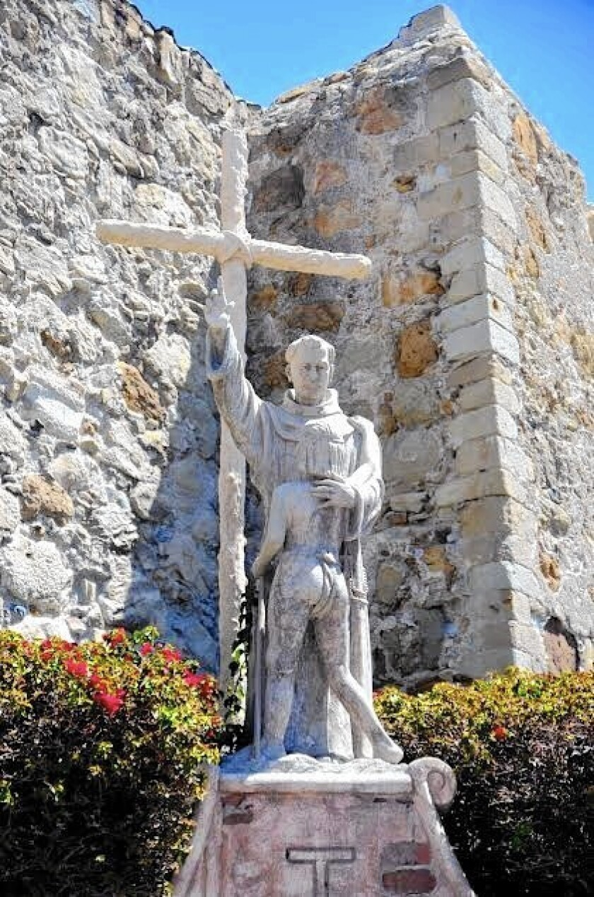 A Father Junipero Serra statue rests on the Mission San Juan Capistrano grounds.