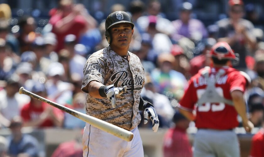 The Padres' Everth Cabrera flings away his bat after striking out to end the sixth inning against the Washington Nationals during a baseball game, Sunday, June 8, 2014, in San Diego. The Padres have struck out 11 times through eight innings while mustering only two hits.