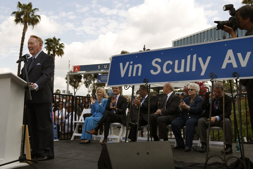 Vin Scully speaks during a ceremony held for his long-time service to the Los Angeles Dodgers after a street leading to Dodger Stadium was named Vin Scully Avenue to honor the longtime Dodger broadcaster who is retiring after this season.