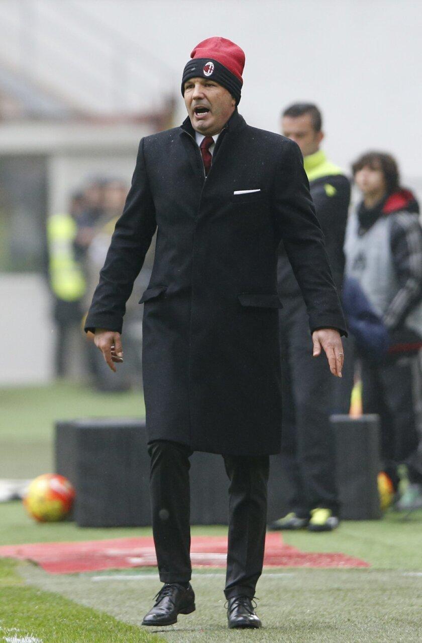 AC Milan coach Sinisa Mihailovic follows a Serie A soccer match between AC Milan and Genoa, at the San Siro stadium in Milan, Italy, Sunday, Feb. 14, 2016. (AP Photo/Luca Bruno)