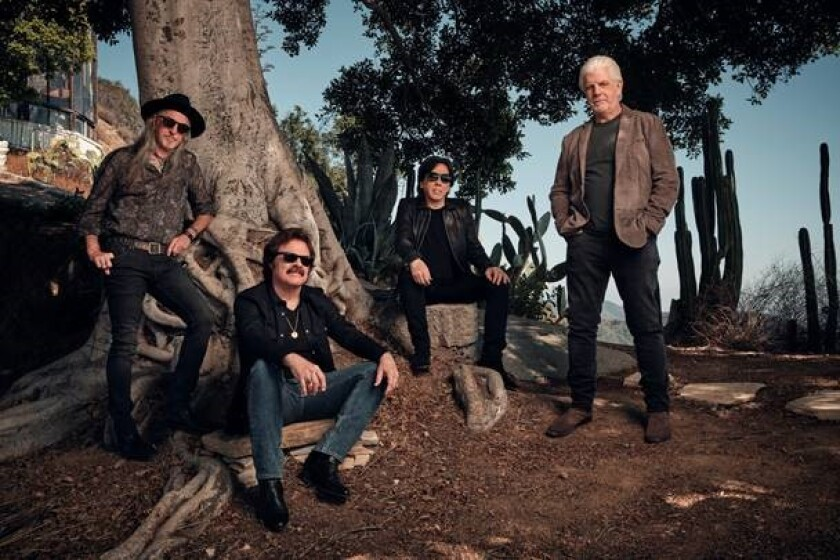The Doobie Brothers, from left, Patrick Simmons, Tom Johnston, John McFee and Michael McDonald