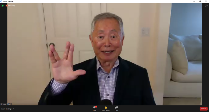 """George Takei makes the """"Live Long and Prosper"""" Vulcan salute during Monday's virtual question-and-answer session."""