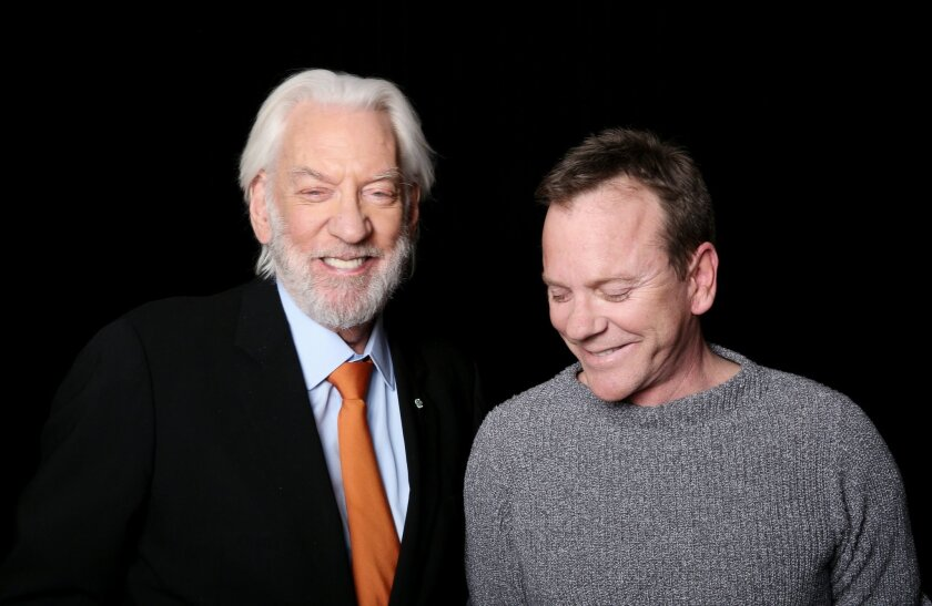 "In this Tuesday, Feb. 16, 2016 photo, Donald Sutherland, left, 80, and Kiefer Sutherland, 49, from the film ""Forsaken,"" pose for a portrait in Los Angeles. The father and son have nearly 275 combined credits and 85 years of experience between them, and have somehow only shared the screen three time"