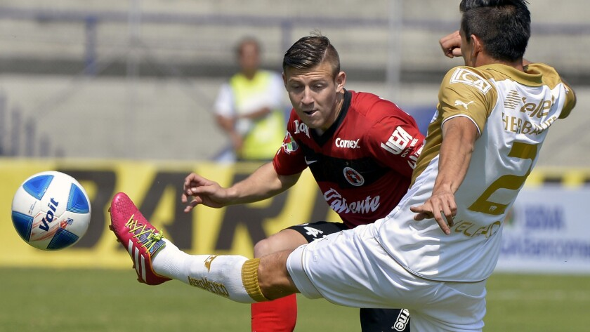 Paul Arriola, shown playing for Mexican club Tijuana, had a successful debut with the U.S. national team on Sunday.