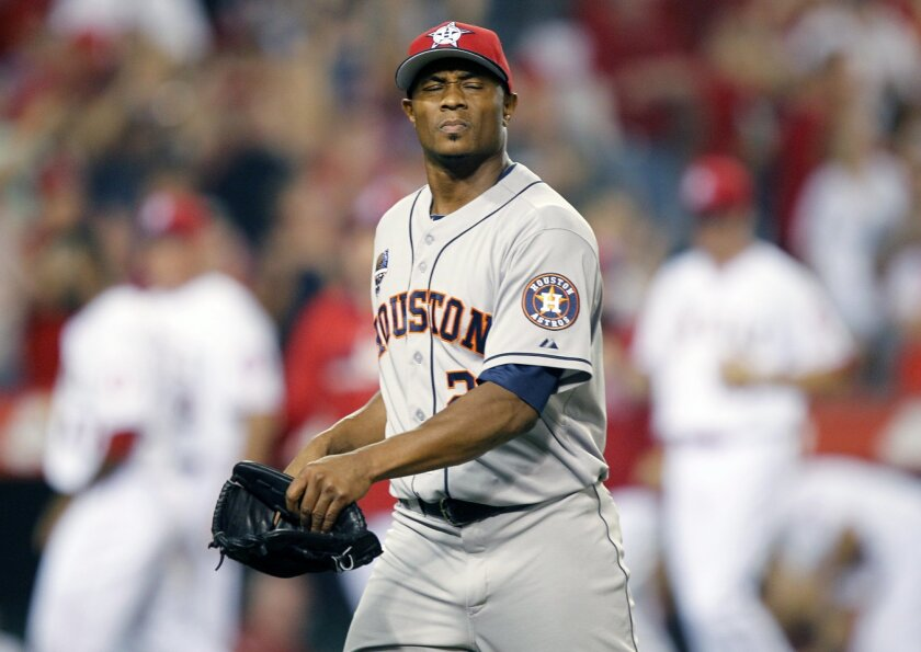 Houston Astros relief pitcher Tony Sipp closes his eyes as he walks off the field after Los Angeles Angels' Mike Trout hit the game-winning home run in the ninth inning to defeat the Astros 7-6 in a baseball game on Friday, July 4, 2014, in Anaheim, Calif. (AP Photo/Alex Gallardo)