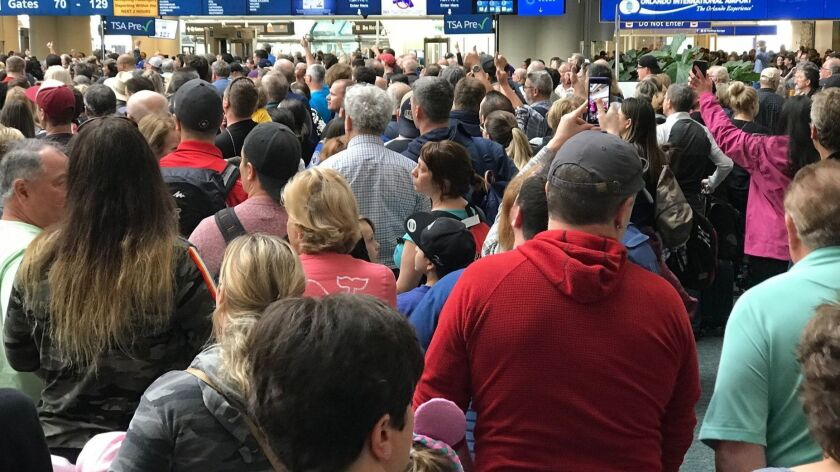 People wait to get through security at the Orlando International Airport following a security incident on Saturday, Feb. 2, 2019.