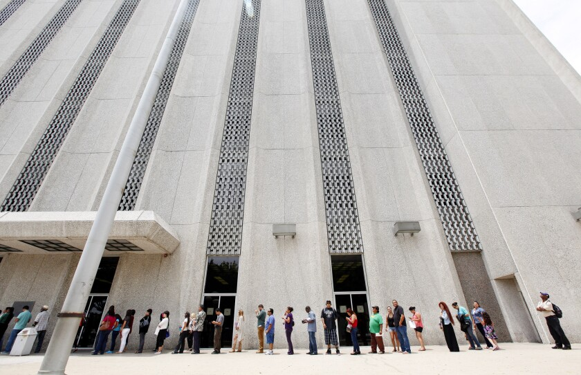 Lines outside of traffic courts in Los Angeles, such as this one, are expected to grow longer following a new wave of cuts within the Los Angeles County court system.