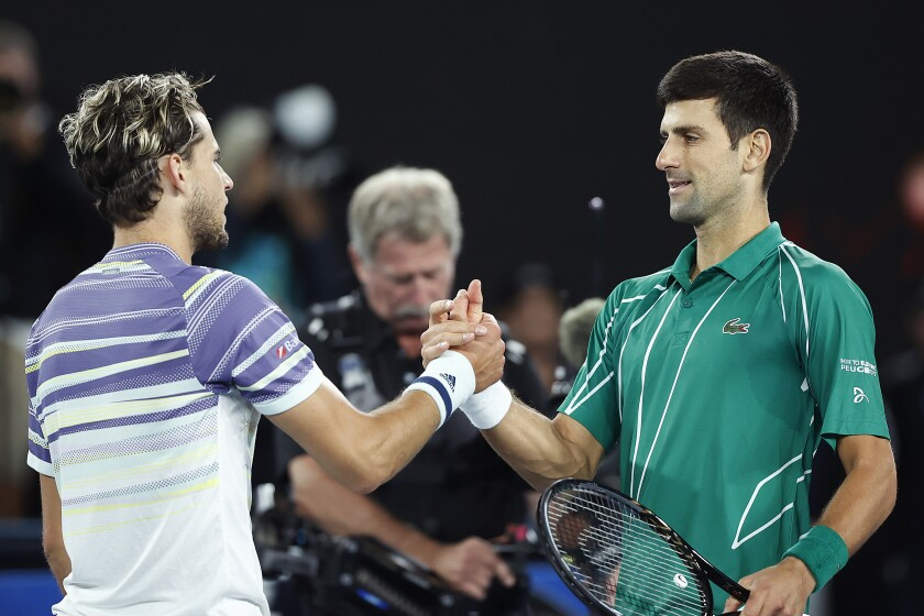 Dominic Thiem, left, shakes hands with Novak Djokovic after their match at the Australian Open in February.
