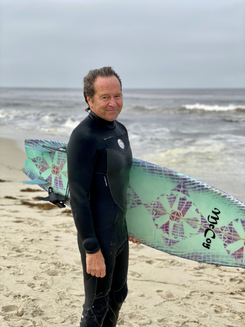 """Surfer and La Jolla resident Jeff McCoy said surfers at Windansea had """"a lot of pent-up energy"""" as the beach reopened April 27 after a month-long closure."""