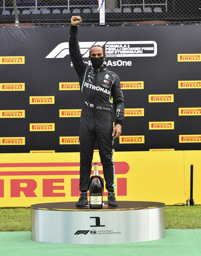 Formula One's Lewis Hamilton raises his right fist on the podium in Spielberg, Austria.