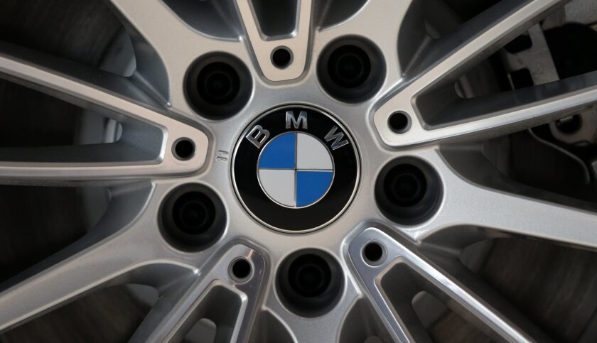 FILE - In this Tuesday, March 19, 2013, file photo, the company logo of car manufacturer BMW is pictured on a car in Munich, Germany. Automaker BMW will report its third-quarter earnings early Tuesday, Nov. 3, 2015. (AP Photo/Matthias Schrader, file)