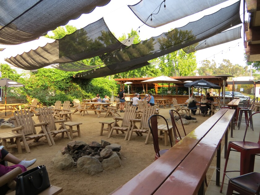 Diners on the back patio at Belching Beaver Brewery Tavern and Grill in Vista
