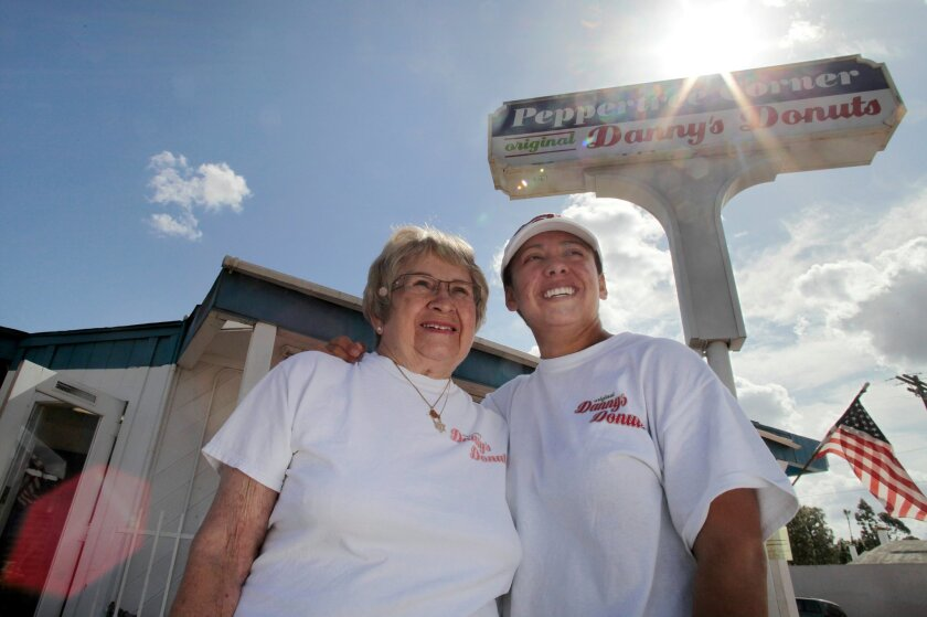 Danny's Donuts' previous owner Marilyn Abeyta, left, sold the shop to Allie Sanchez and her husband Cesar. The new owners say the name and the recipes will remain the same.