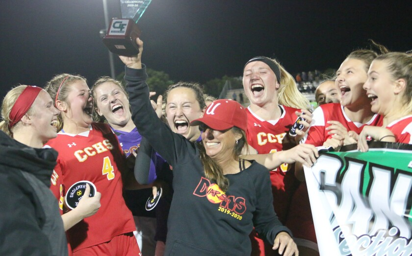 Cathedral Head Coach Dawn Lee and the CIF trophy.