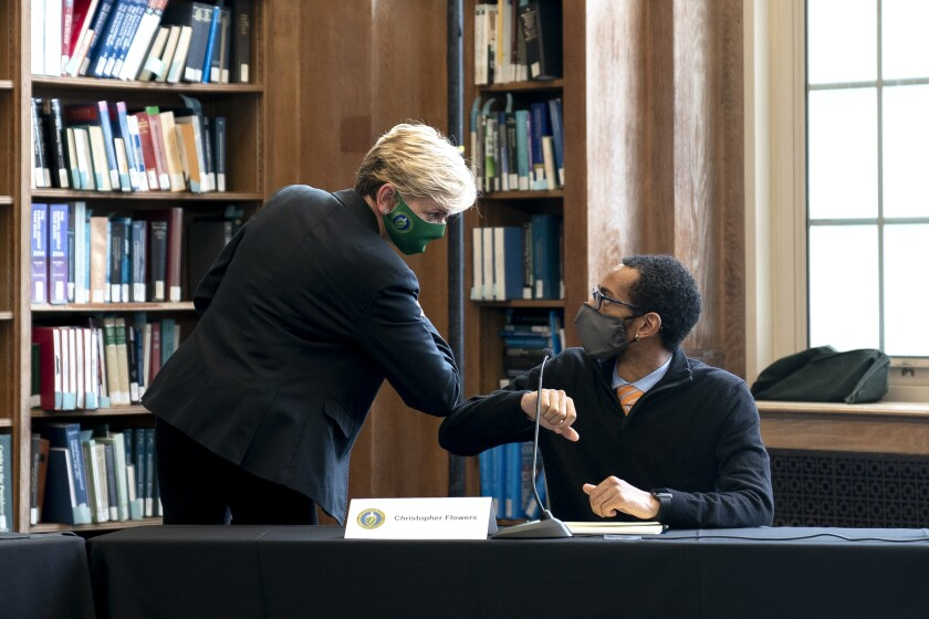 Energy Secretary Jennifer Granholm elbow bumps student Christopher Flowers after a roundtable discussion at Howard University in Washington, Monday, May 3, 2021. (Stefani Reynolds/Pool via AP)