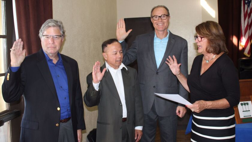 New and returning trustees Michael Dershowitz, Julio de Guzmán and John Shannon are sworn in by La J