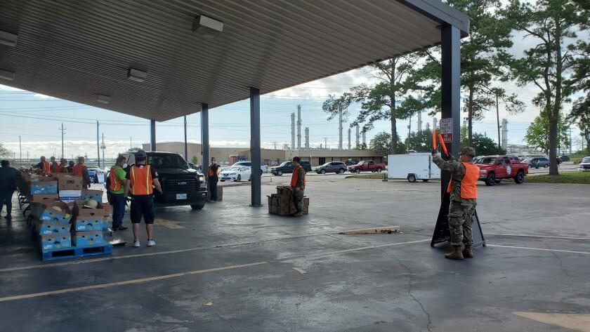 Volunteers distribute food in the refinery town of Baytown, Texas.
