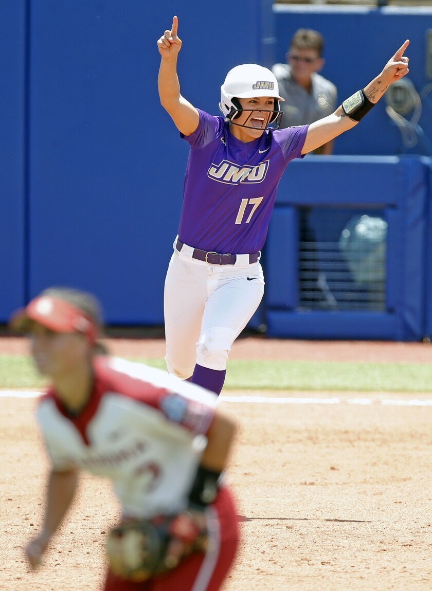 James Madison's Kate Gordon (17) celebrates her home run in the eighth inning of a Women's College World Series softball game against Oklahoma in Oklahoma City, Thursday, June 3, 2021. James Madison beat top-seeded Oklahoma 4-3 in eight inning. (Sarah Phipps/The Oklahoman via AP)