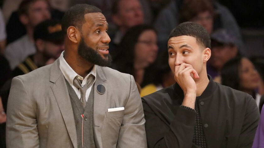 LOS ANGELES, CALIF. - JAN. 29, 2019. Injured Lakers players LeBron James and Kyle Kuzma watch the ga