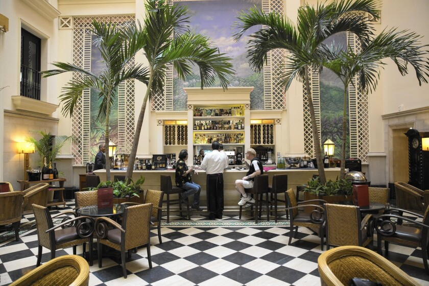 Be aware that hotels can charge fees for exchanging currency. Here, the lobby of the Hotel Saratoga in Havana.